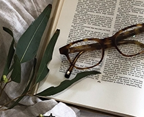 Trendlines Story Inspiration | Tortoiseshell Glasses on open book